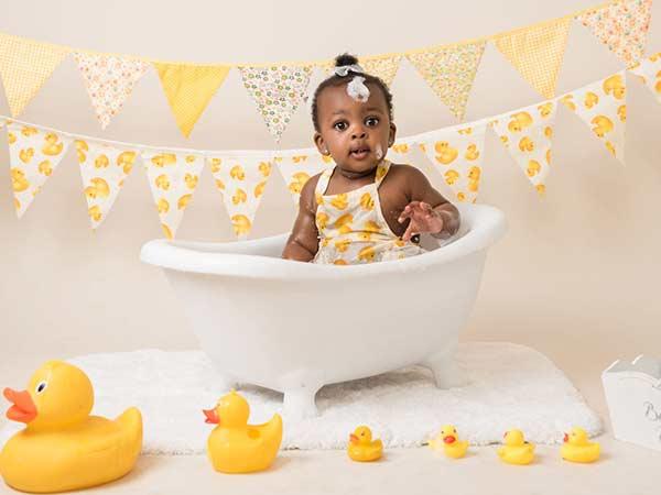 Beautiful girl splashing in a bath tub photoshoot