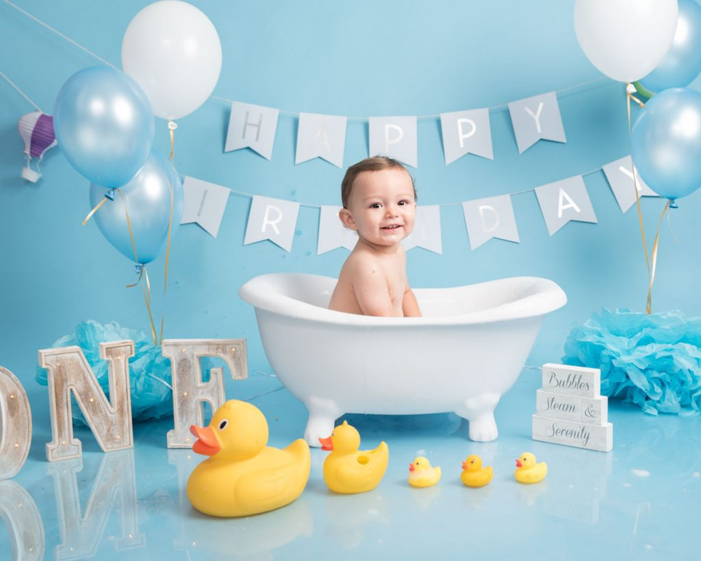 blue themed baby first birthday in the bath and splash