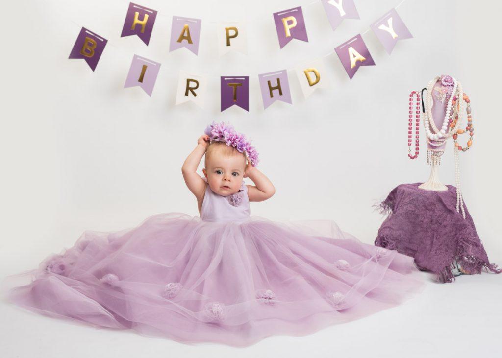 purple themed first birthday baby photoshoot
