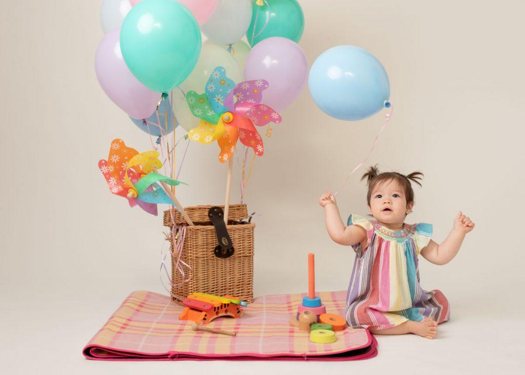 balloons and picnic fun first birthday shoot