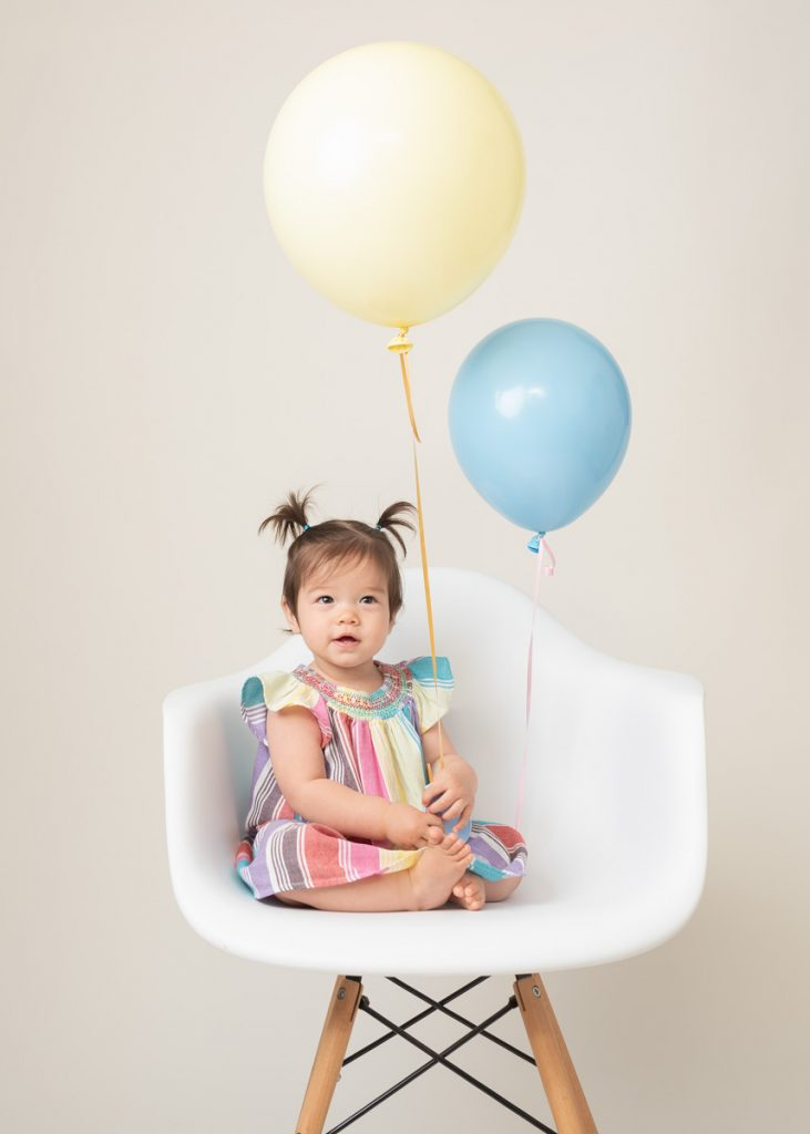 two balloons and a gorgeous little girl