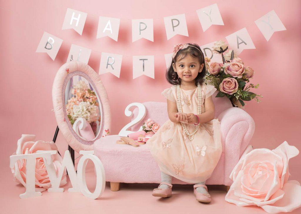 gorgeous little girl enjoying her second birthday photoshoot
