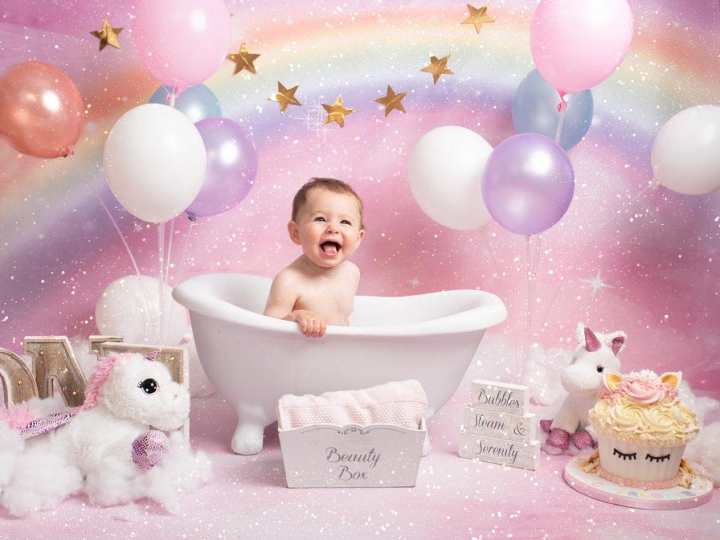 baby girl in a bathtub, smiling