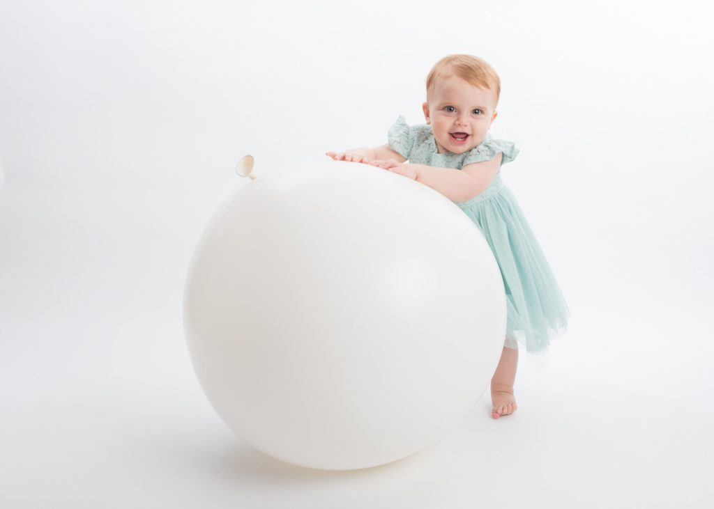 little baby girl with a gigantic balloon