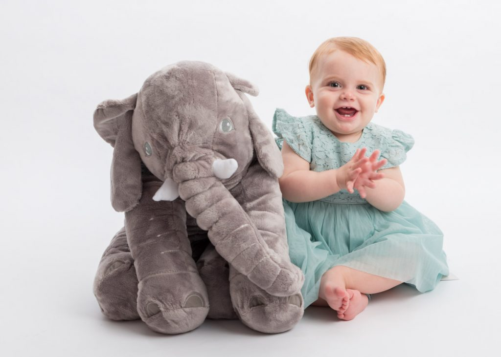 little girl with her stuffed elephant
