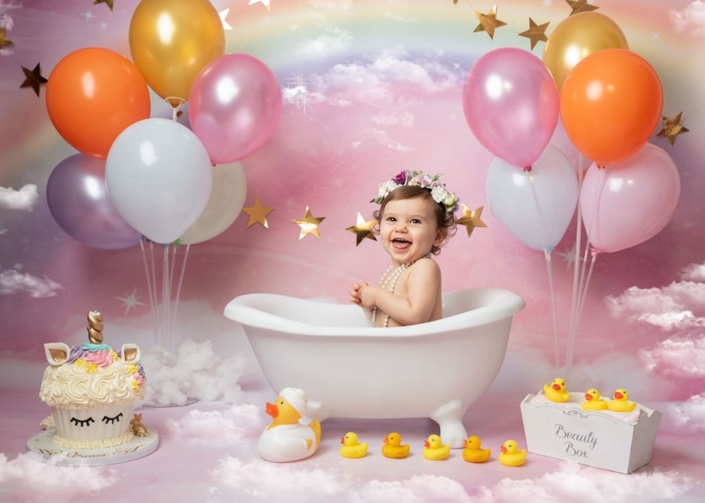 baby girl in the bath with balloons for a splash photoshoot