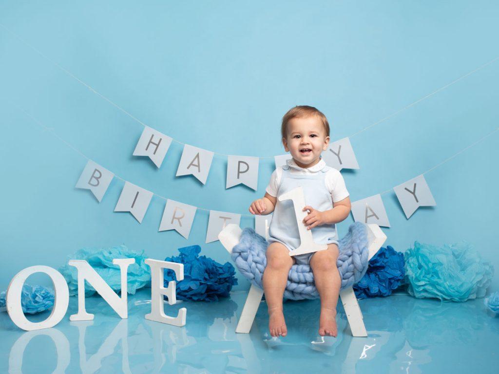 baby sitting in the baby photoshoot studio