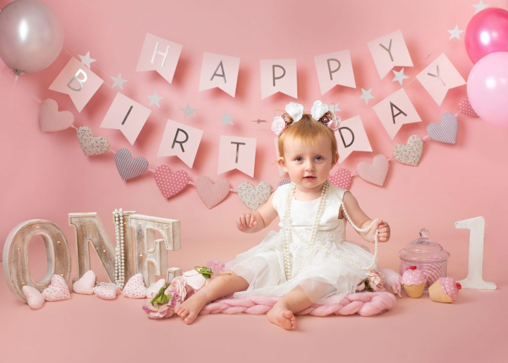 baby girl with pearls for birthday baby photos
