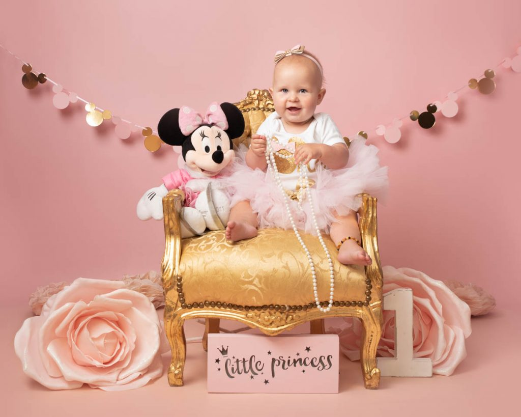 little princess baby girl with pearls and minnie mouse on a throne for sitter session photography