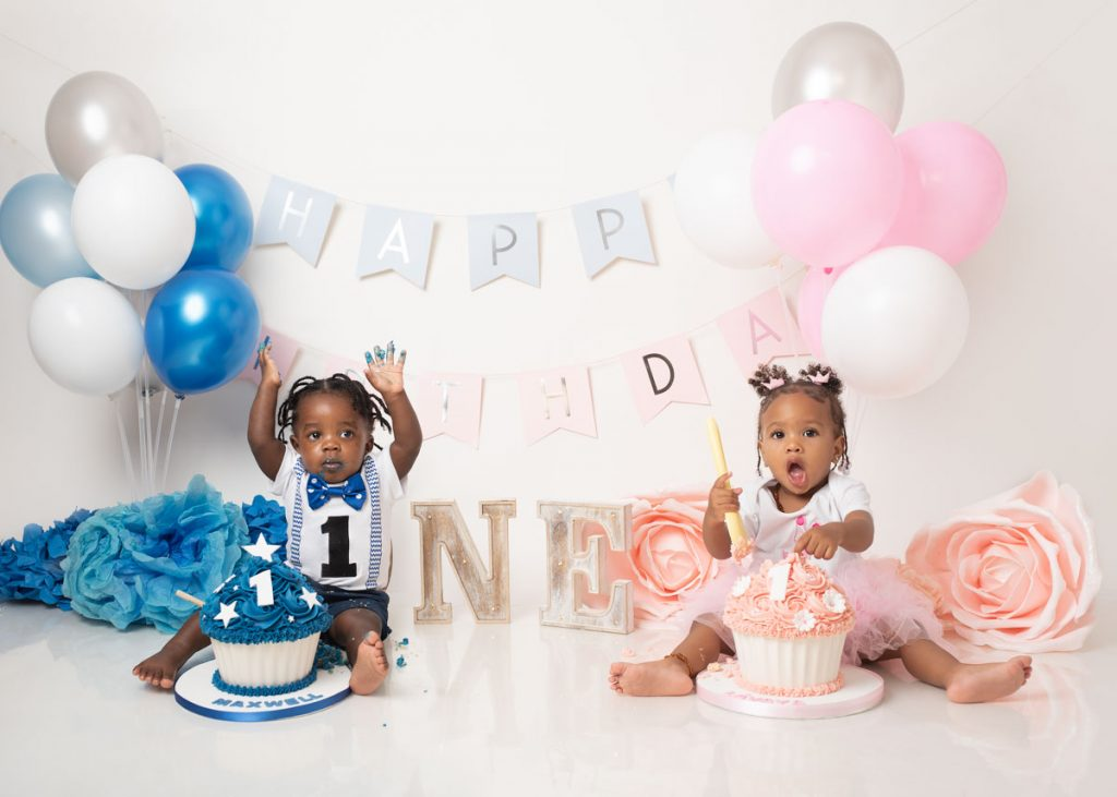 Boy and girl twins set for a cake smash photo session