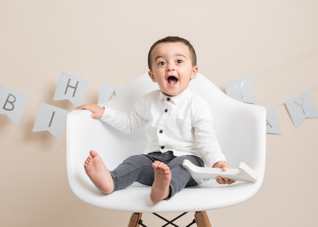 Young boy on a chair for a child portrait