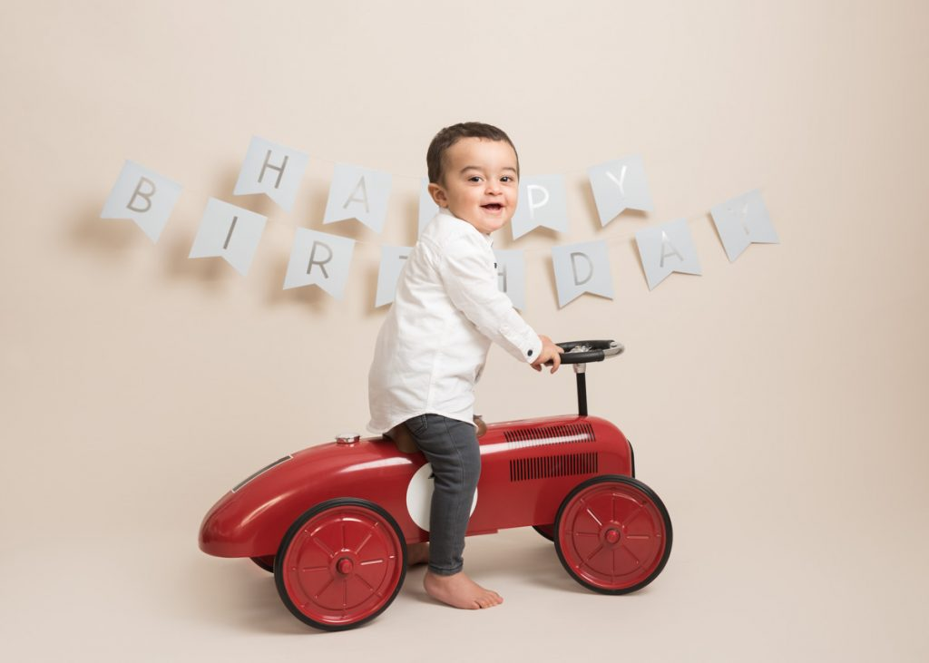 Young boy on a ride on car for kids photoshoot