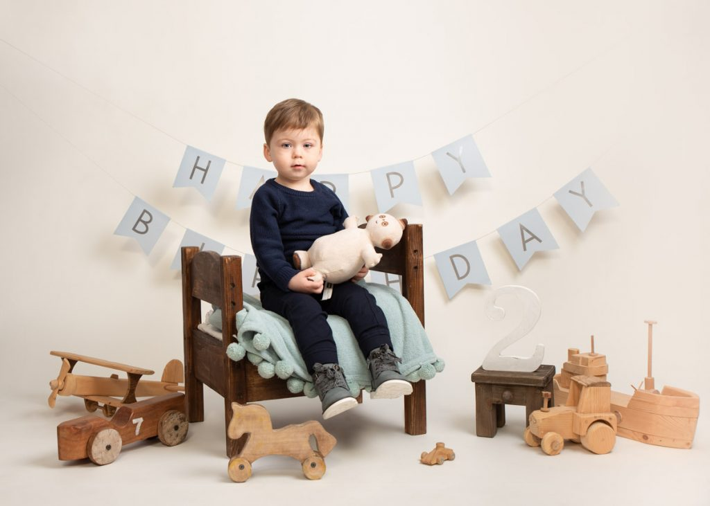 Boy with toys sitting for kids photography