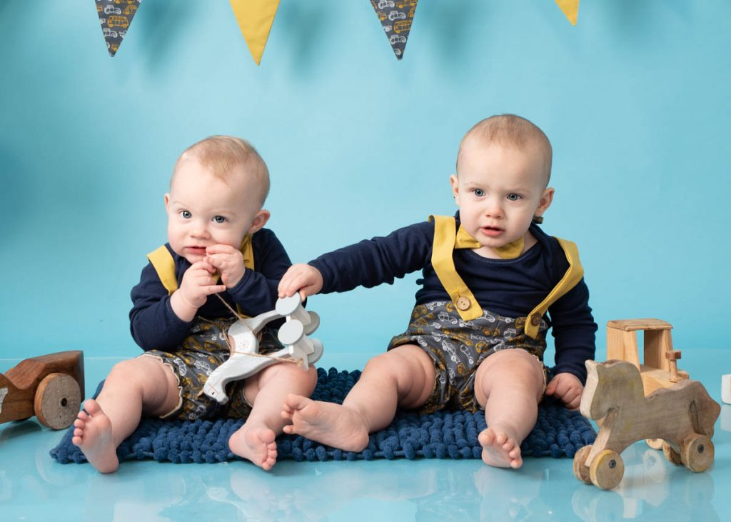 Twins sitting for baby photoshoot