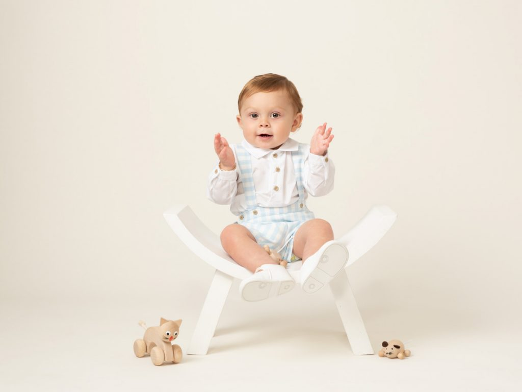 cute baby in a chair photoshoot