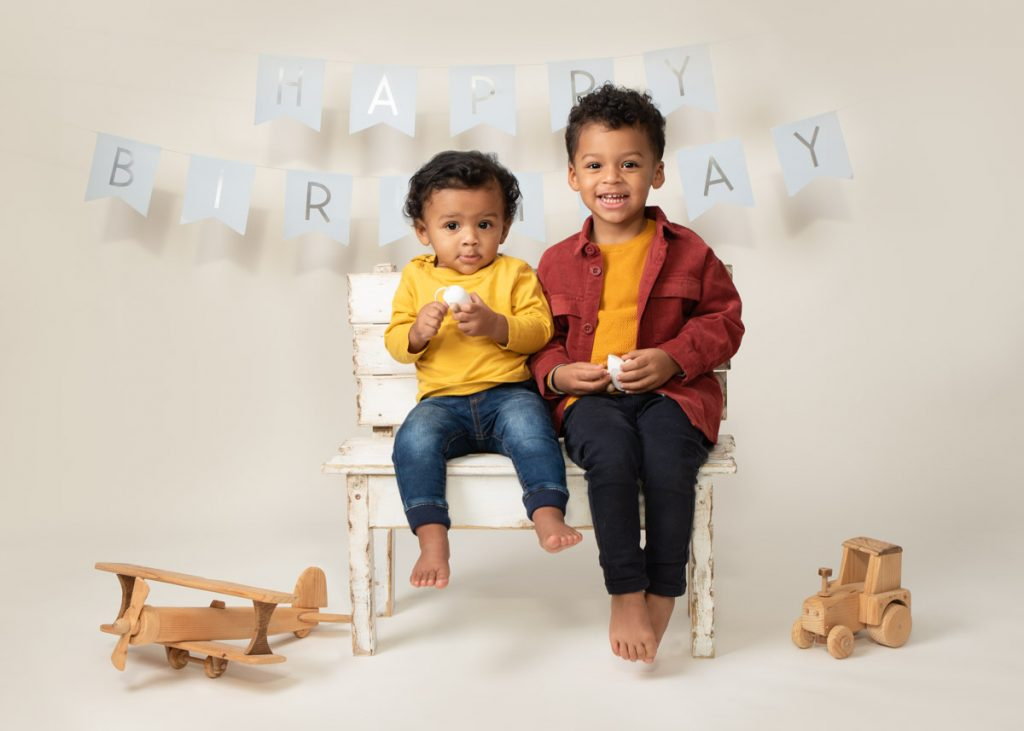 family children together first birthday photoshoot
