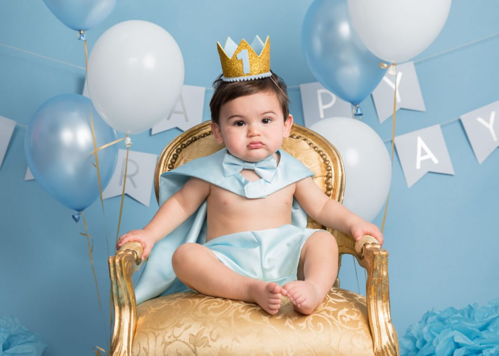 blue king of the throne themed toddler and bigger baby photoshoot