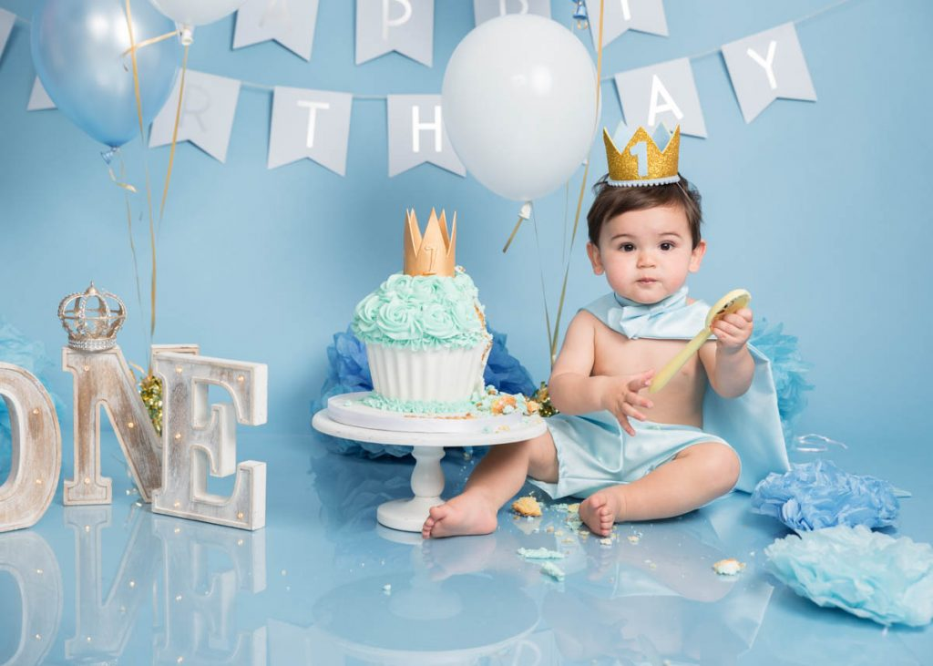 blue king themed toddler and bigger baby photoshoot
