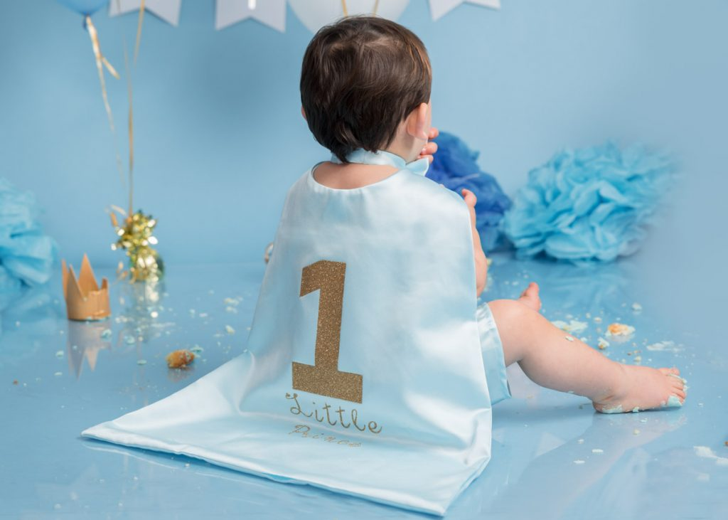 blue cape themed toddler and bigger baby photoshoot