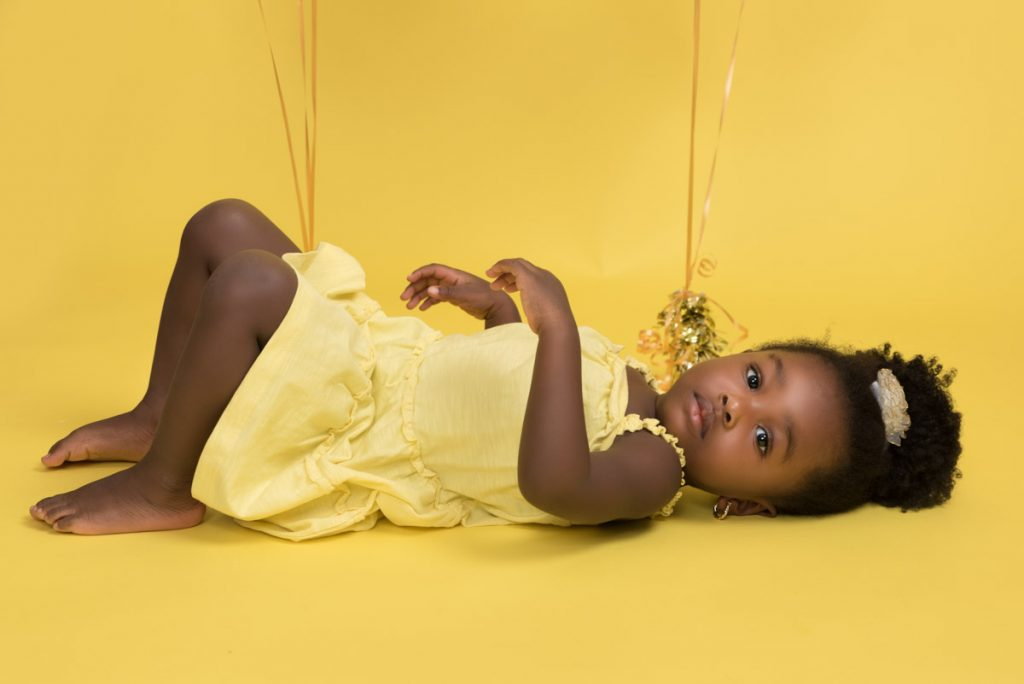 yellow themed toddler and bigger baby photoshoot