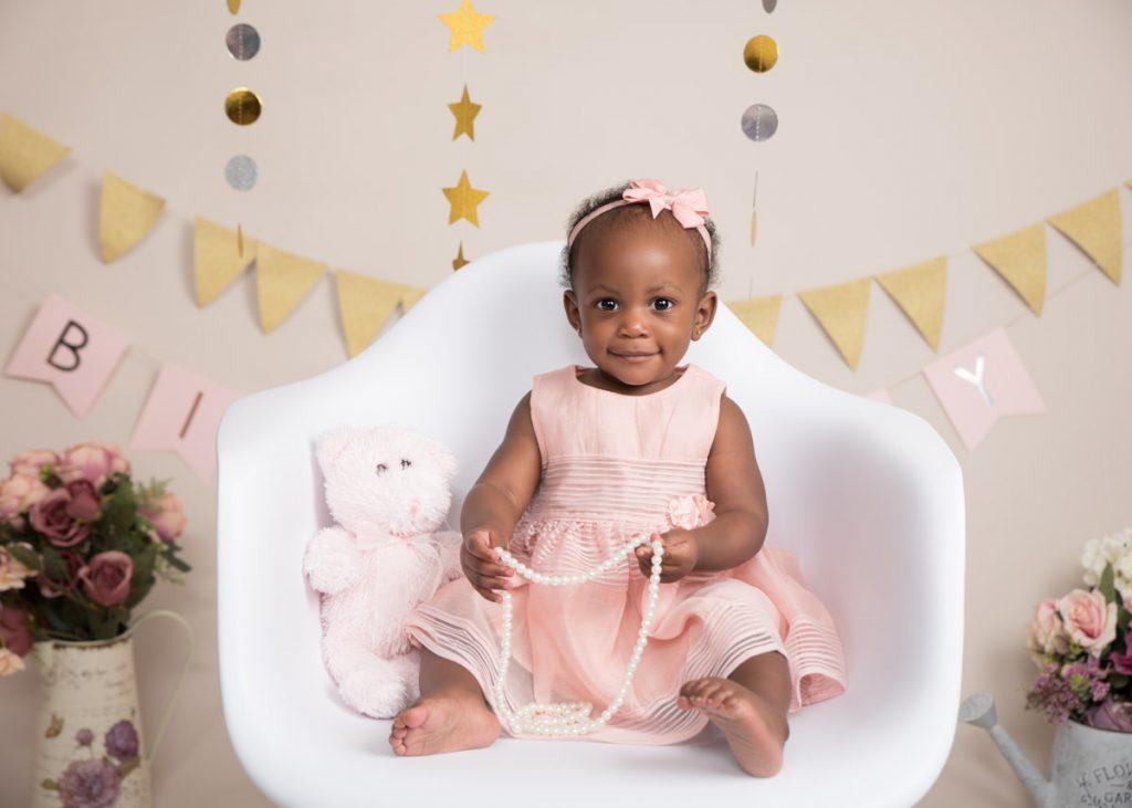 smiling little baby girl enjoying her first birthday