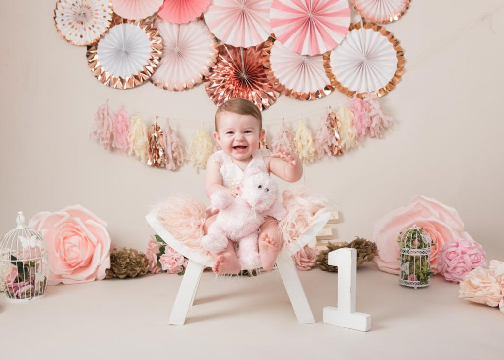 pink and floral themed first birthday photoshoot