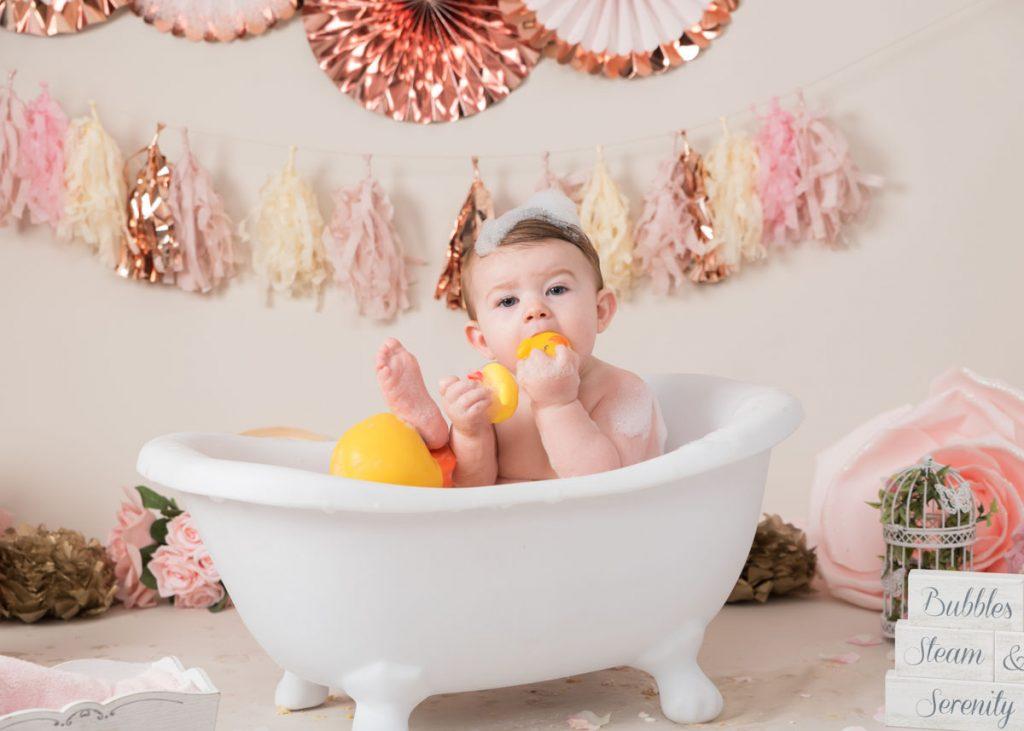 baby eating her rubber ducks