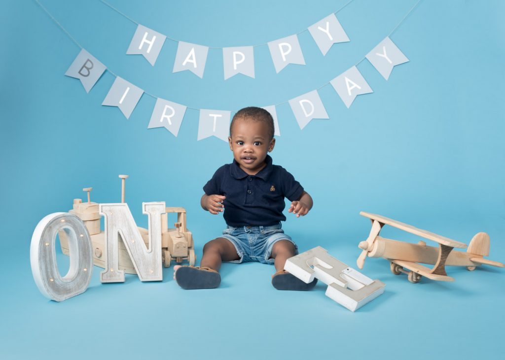 first birthday with a plane and the number one. Adorable baby photoshoot