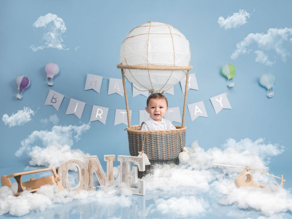 little boy's first birthday going up into the sky in a hot air balloon