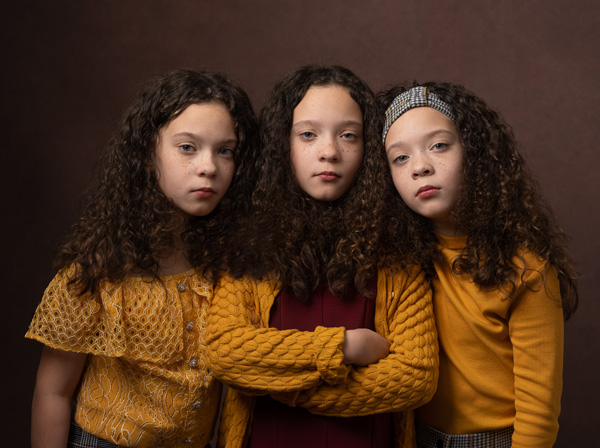 triplets with dark curly hair fine art photography