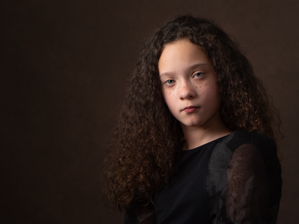 girl with dark curly hair fine art photography session