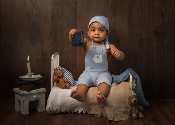 Asian baby in sleep suit