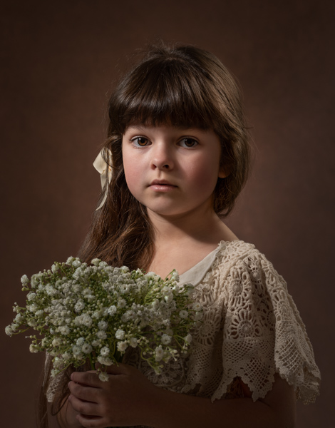 girl with long chestnut hair and flowers
