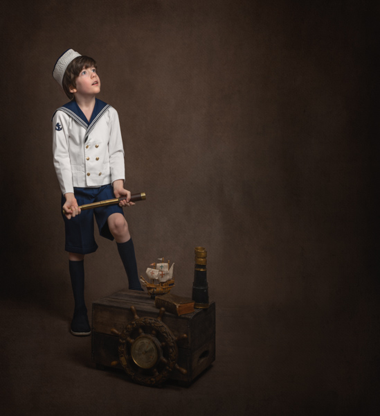 young sailor boy playing for a fine art photography session