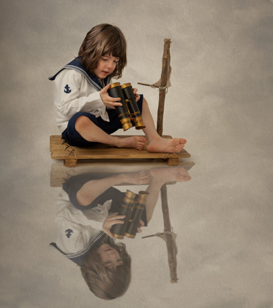 boy with long hair and binoculars and a sailor outfit