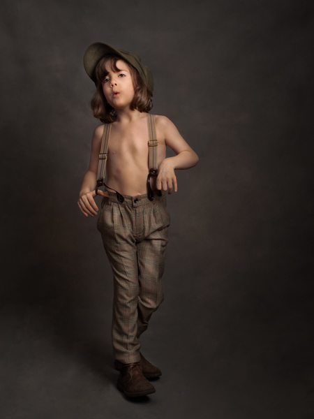Young boy dressed as a shoe shine boy for fine art photography