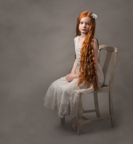 young girl with red hair sitting for fine art photography session
