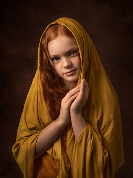 young girl with red hair and cowl