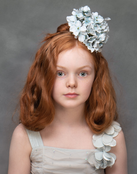 young girl with red hair and flowers