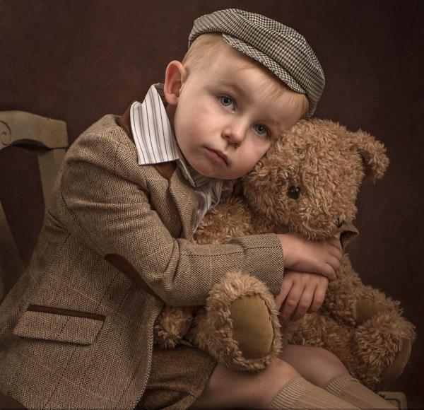 boy in tweed with a teddy bear