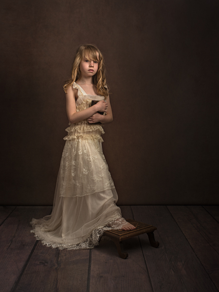 Girl with curly blond hair standing for a fine art photo session