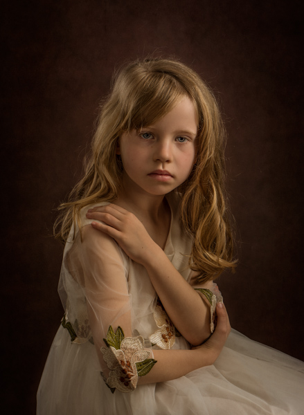 Girl with curly blond hair for a fine art photo session