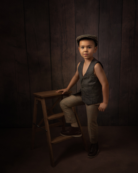 Young boy dressed as a peaky blinder for fine art photography