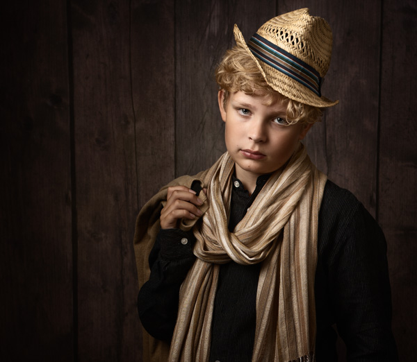 Young boy with jaunty hat for a fine art photography session