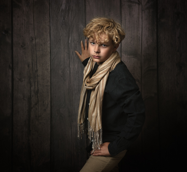 Young blond boy having a fine art photography session