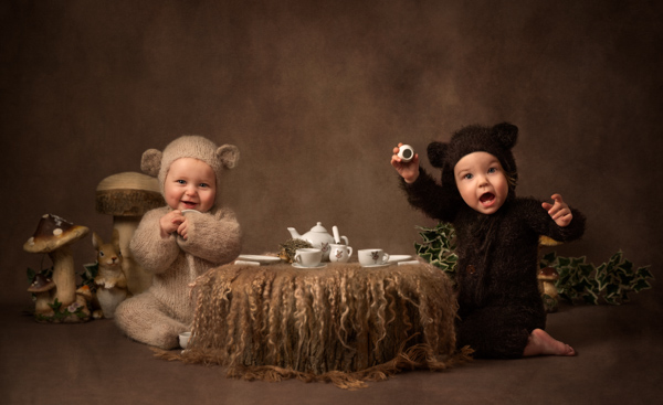 two babies dressed as bears having a picnic for a fine art photography session