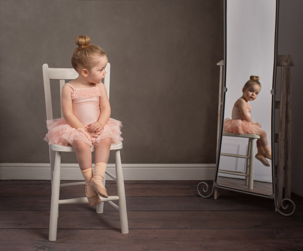 baby ballerina looking at herself in the mirror