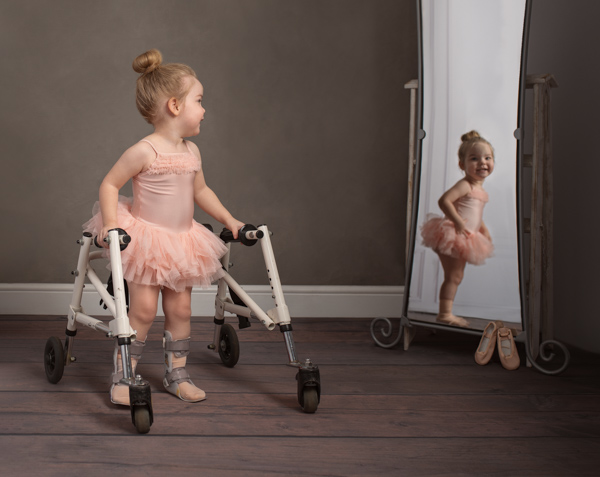 beautiful baby ballerina with a walker
