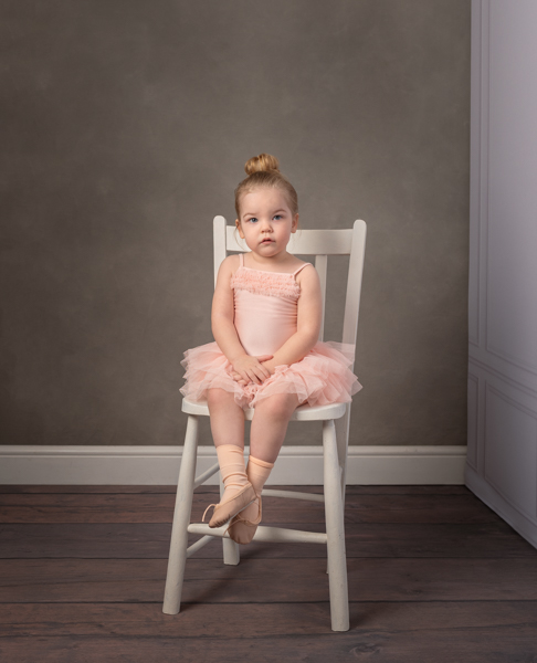 baby ballerina on a white chair