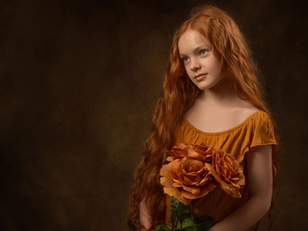 gorgeous red haired girl with flowers